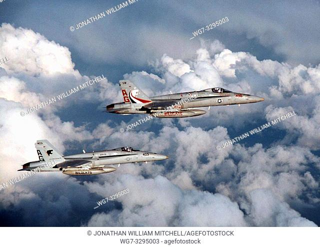 """PERSIAN GULF -- 25 Mar 1996 -- Two F/A-18C Hornets from the """"Wildcats"""" of Strike Fighter Squadron One Three One (VFA-131) patrol the skies over the Arabian Gulf"""