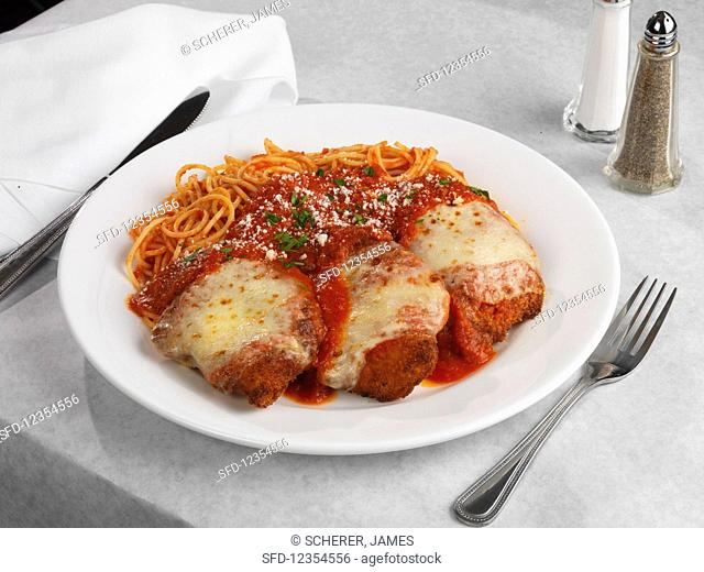 Chicken breasts with ham and cheese, baked in tomato sauce, served with spaghetti