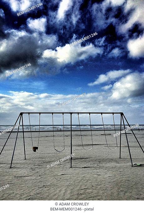 Empty swing set on beach, Seaside, Oregon, United States