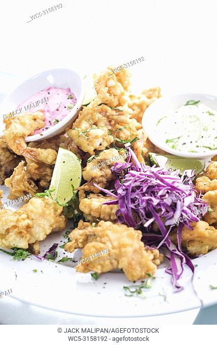 gourmet calamari tempura squid with tzatziki and pickled beetroot sauce meal
