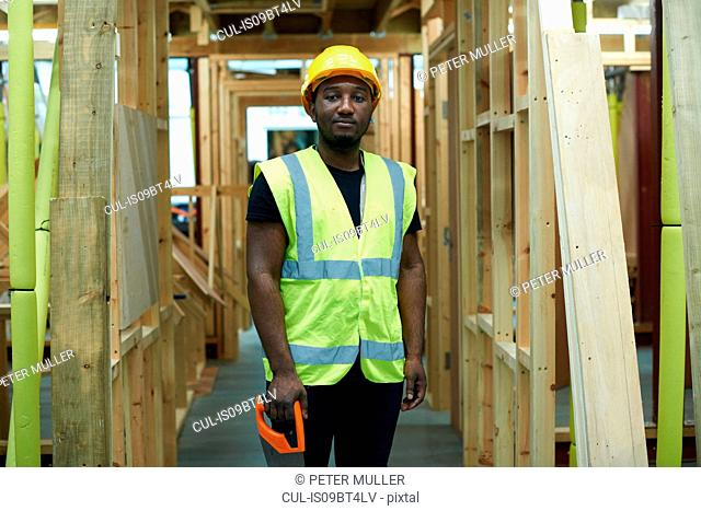 Male higher education carpentry student in college workshop, portrait