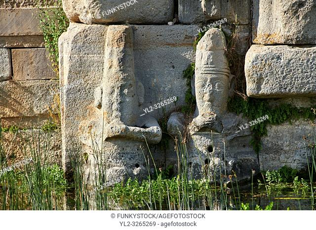 Close up of lower relief sculptures of Hittite gods at Eflatun P?nar ( Eflatunp?nar) Ancient Hittite relief sculpture monument and sacred pool