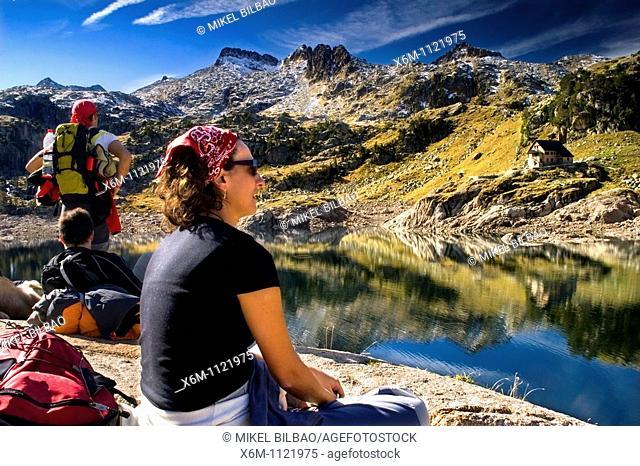 people near the Bigger Lake of Colomer and Colomer I mountain hut  Colomers glaciar cirque  Aran Valley  Pyrenees mountain range  Lerida province  Catalonia