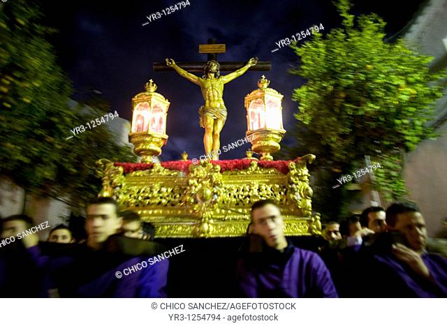 Men carry the statue of the Christ of Good Death during a Holy Week procession in the town of Prado del Rey in southern Spain's Cadiz Sierra region in Andalucia...