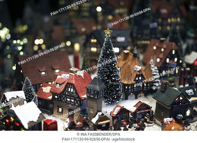 Porcelain houses with a Christmas tree can be seen at the Christmas market in Dortmund, Germany, 30 November 2017. Photo: Ina Fassbender/dpa