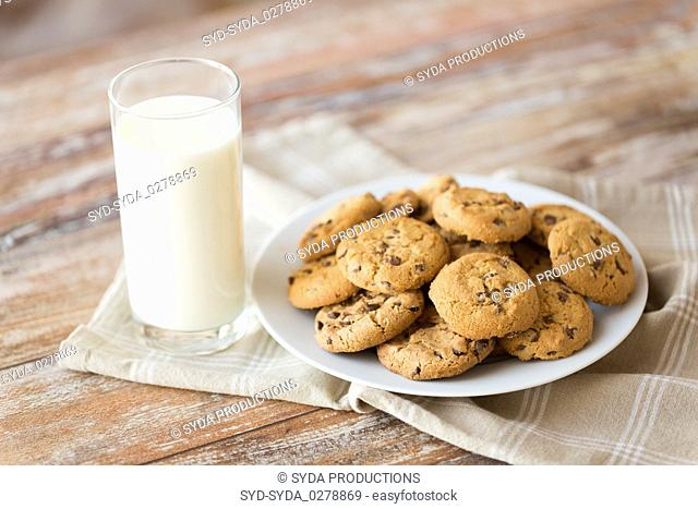 close up of oatmeal cookies and glass of milk
