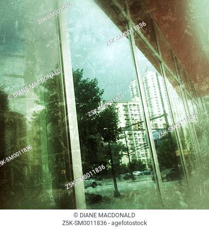 Reflections of Peachtree Street, Atlanta, Georgia in a window