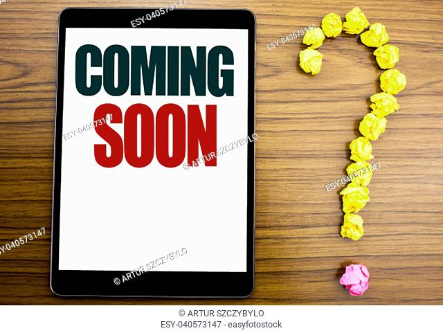 Word, writing Coming Soon. Business concept for Under Construction Written on tablet, background with question mark on the end