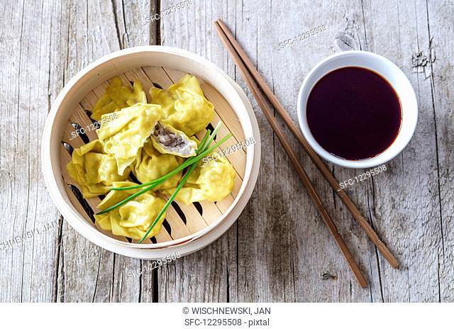 Won tons with plum sauce (China)