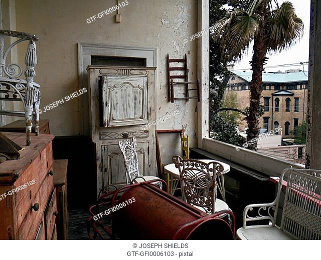 Antique furniture on back porch of Raskin's Antiques