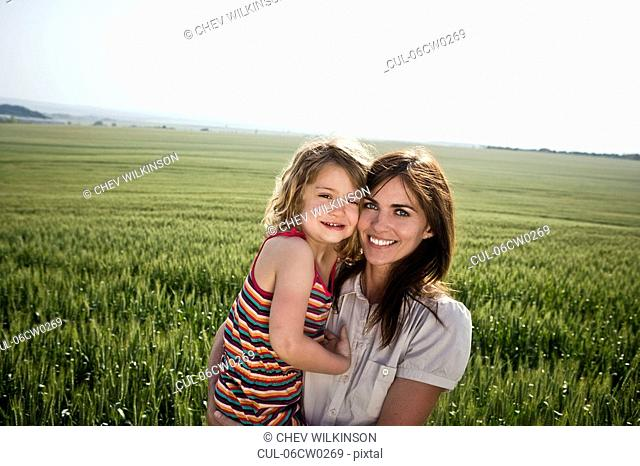 Woman and child in wheat-field