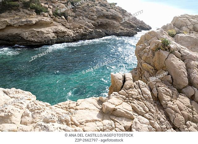 Mediterranean sea, Costa Blanca, Villajoyosa, Spain. Sea blue waters and pebbled coast