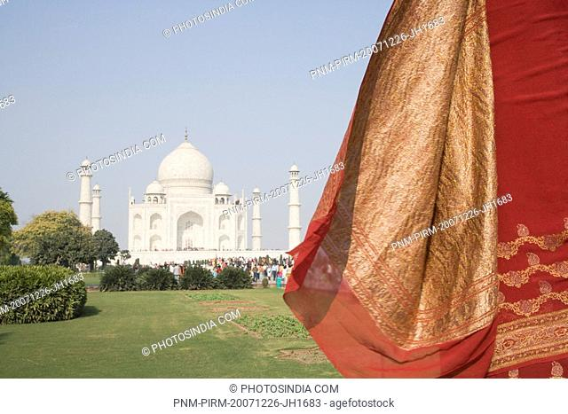 Rear view of a woman standing in front of a mausoleum, Taj Mahal, Agra, Uttar Pradesh, India