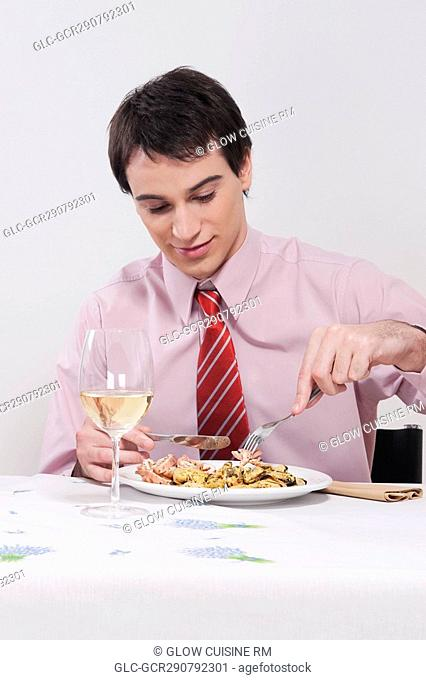 Businessman having lunch with white wine