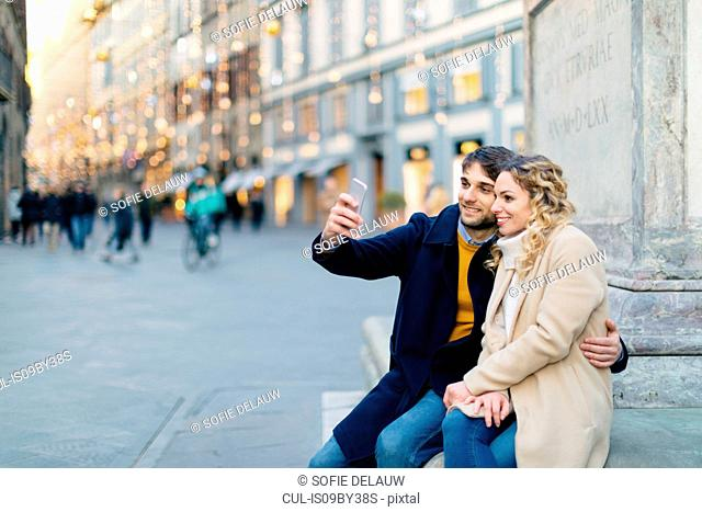 Couple taking selfie at piazza, Firenze, Toscana, Italy