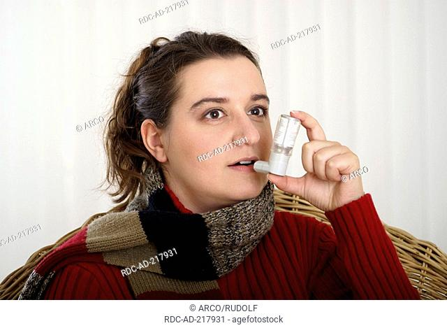 Woman with aspirator, asthma, bronchitis, scarf