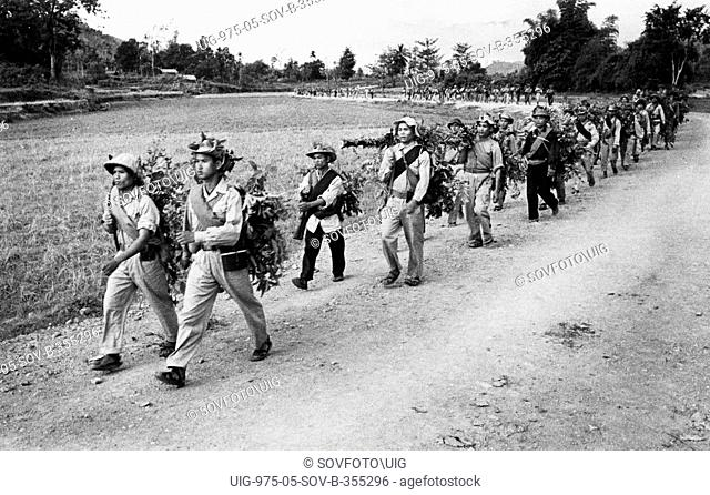 Troops of the south vietnam liberation army marching towards the front along the ho chi minh trail, vietnam war, september 1966