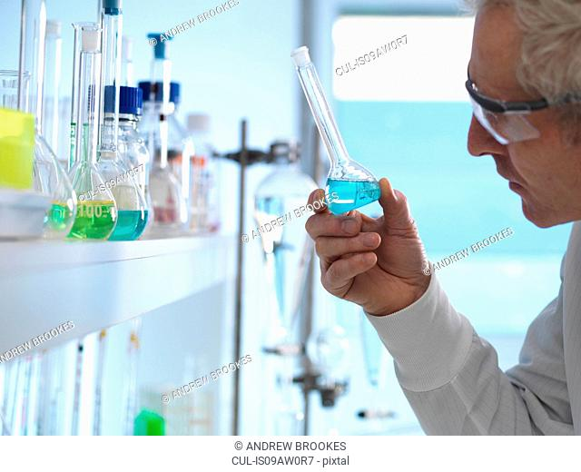 Chemist preparing chemical formula for testing in laboratory