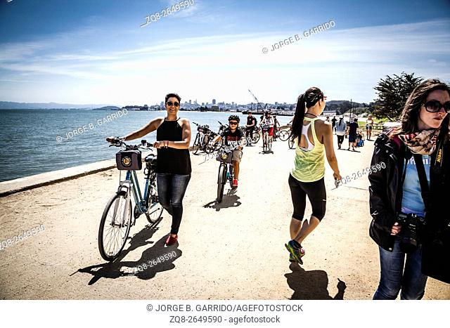 people cycling in the Presidio near the Golden Gate Bridge in San Francisco