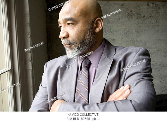 Serious African businessman with arms crossed