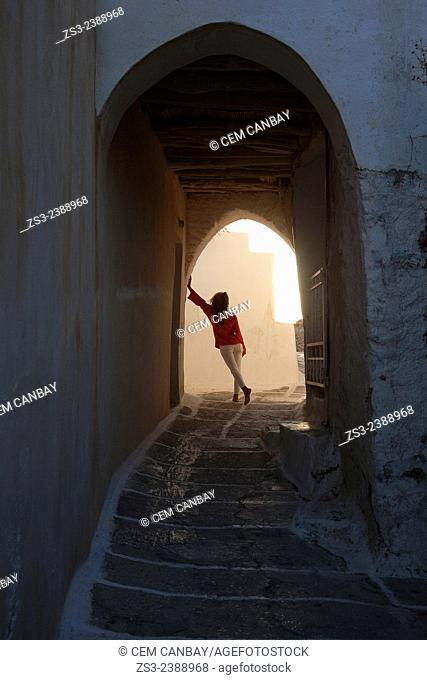Woman by the archway in town center Chora, Ios, Cyclades Islands, Greek Islands, Greece, Europe