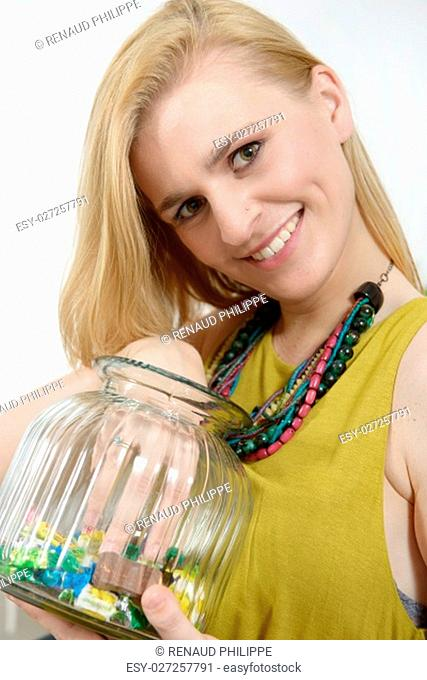 portrait of beautiful young blonde woman with box of candies