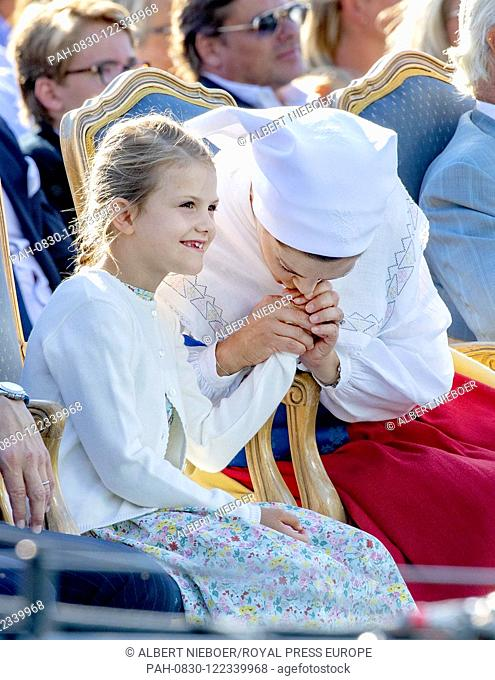 Crown Princess Victoria and Princess Estelle of Sweden at the Borgholm Sports Arena in Borgholm, on July 14, 2019, .to attend the celebration of Crown Princess...