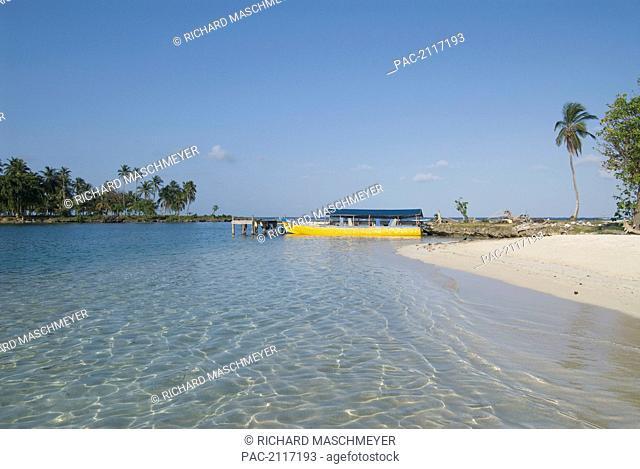 Panama, San Blas Islands (Also Called Kuna Yala Islands), Yandup Island, Small Beach With Boat At The Dock
