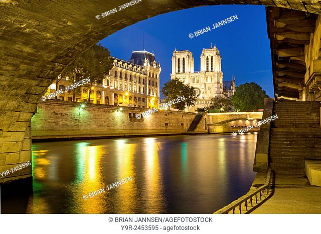 Twilight under Pont Saint Michel with Cathedral Notre Dame, River Seine and Prefecture de Police, Paris, France