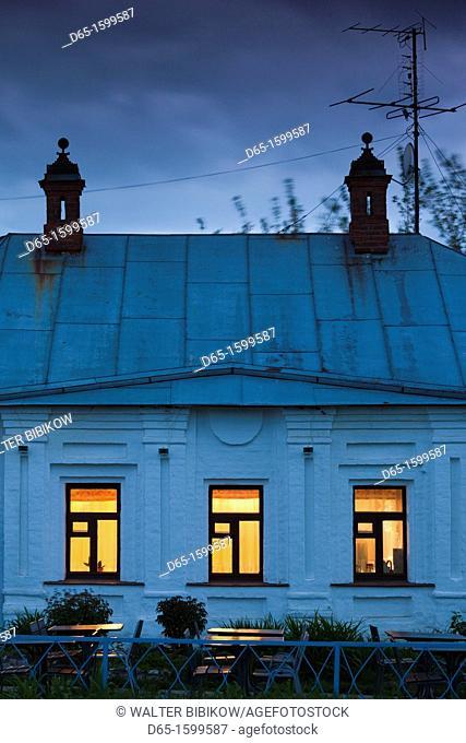 Russia, Vladimir Oblast, Golden Ring, Suzdal, lit restaurant windows, dusk