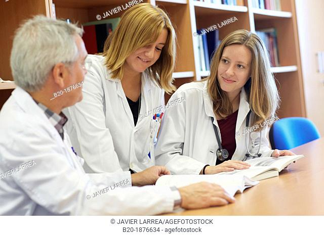 Doctor teaching medical students in library, Doctors in meeting room, Hospital Donostia, San Sebastian, Gipuzkoa, Basque Country, Spain