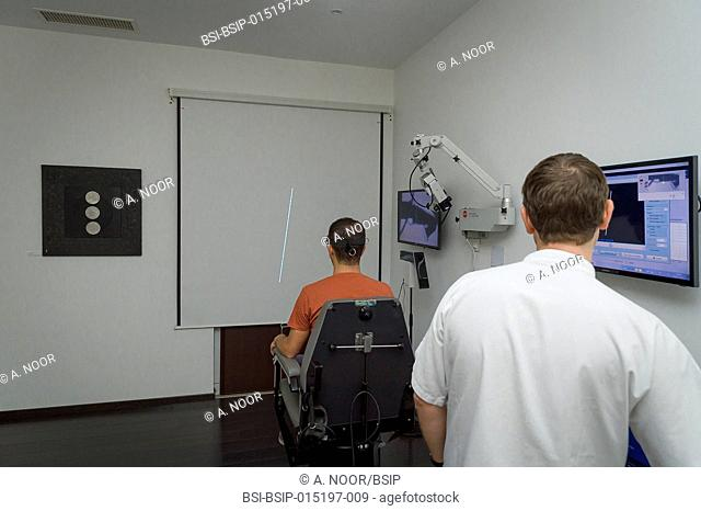 Reportage on an ENT doctor in Nice, France, treating patients suffering from dizziness. Analysing the capacity to determine the vertical position (subjective...