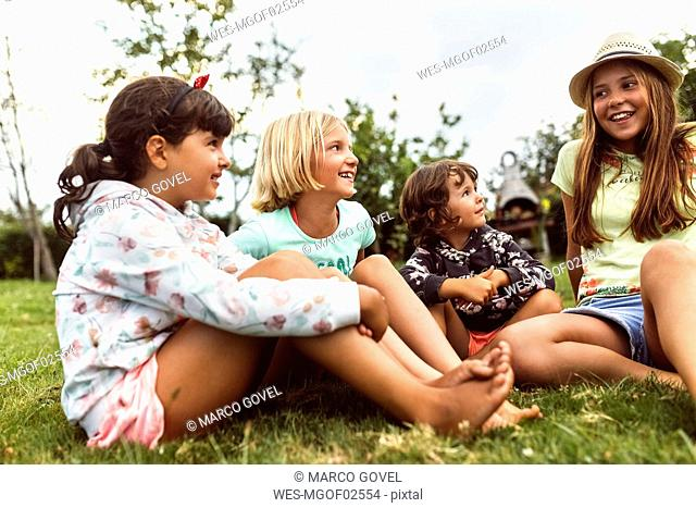 Four girls talking together on a meadow