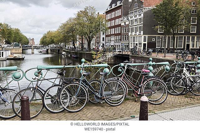 View along Geldersekade Canal, Amsterdam, Netherlands