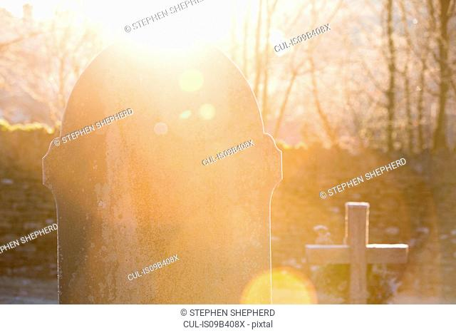 Sunlight on gravestone in cemetery