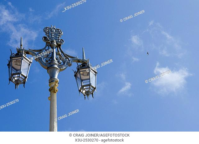 Ornate street lamp on the seafront of Brighton and Hove, East Sussex, England