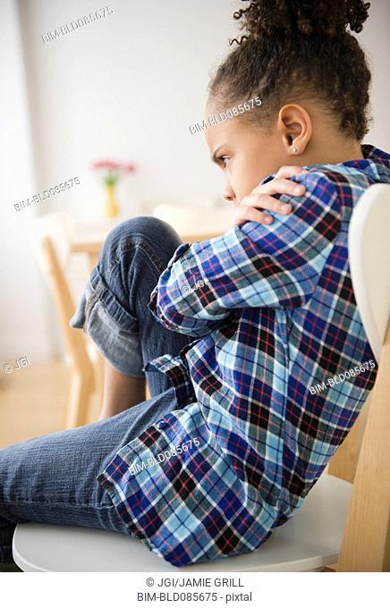 African American girl having temper tantrum