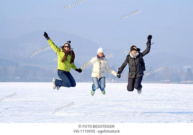 AUSTRIA, STUBENBERG, 12.01.2009, three young women jumping with ice skates - Stubenberg, Steiermark, Austria, 12/01/2009