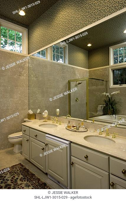 BATHROOM: wallpaper on the ceiling and upper walls, tile to the window meeting the wallpaper, one wall has a long mirror to reflect the opposite tub and shower...