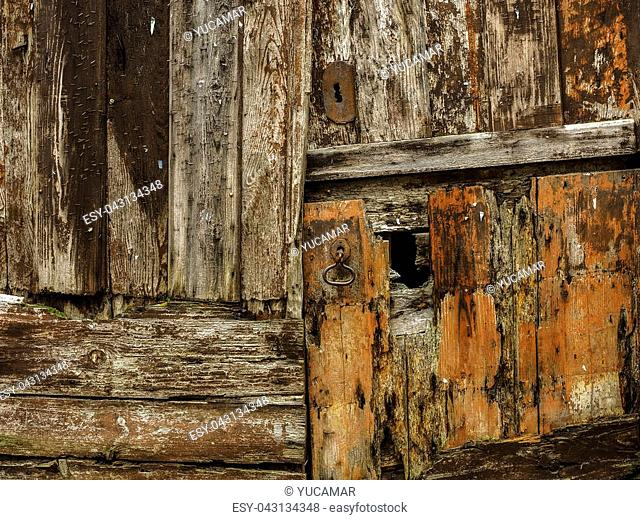 Background of an aged wooden door with the passage of time