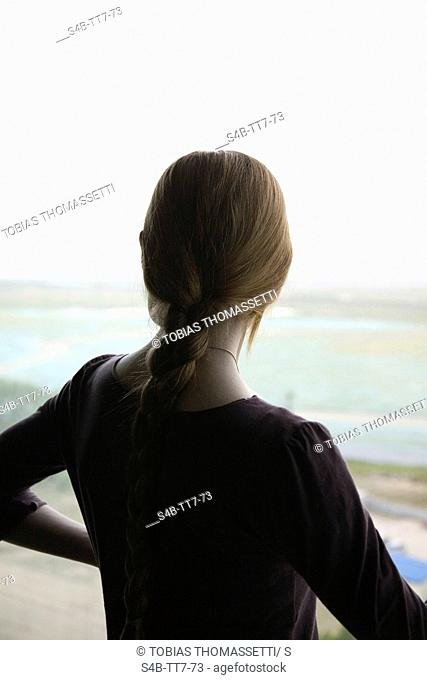 Young woman with plait looking at view, Seoul, South Korea
