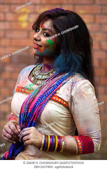 DHAKA, BANGLADESH - MARCH 23 : Bangladeshi youth playing coloured powders during Holi celebrations in Dhaka, Bangladesh on March 23, 2016