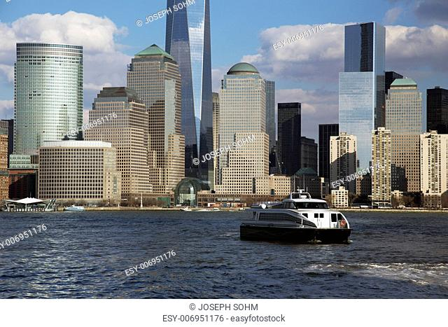 New York City Skyline on water featuring One World Trade Center (1WTC), Freedom Tower, New York City, New York, USA City, New York, USA
