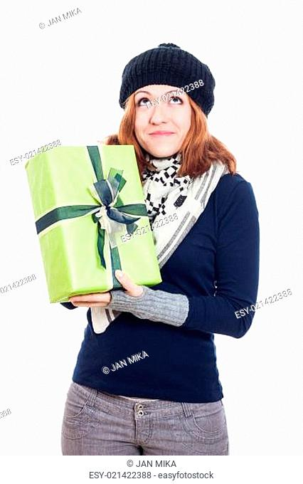 Pleased winter woman with present