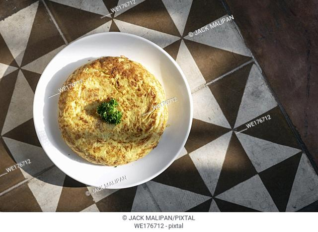 spanish tortilla omelet traditional tapas food on traditional rustic old tiles background in seville