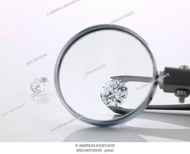 Magnifying glass over diamond