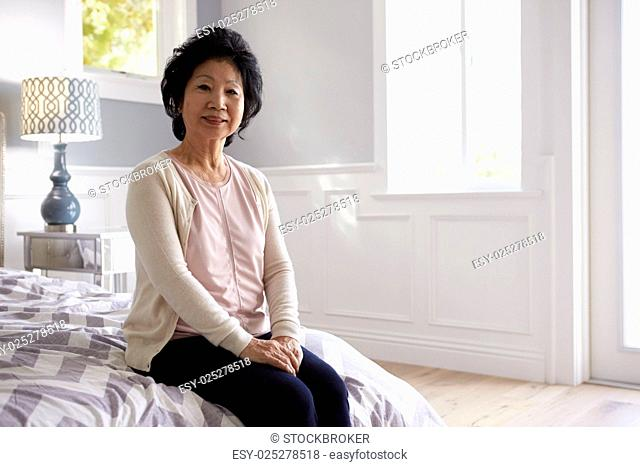 Portrait Of Senior Woman In Bedroom Of Home