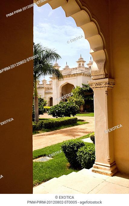 Formal garden of a Palace viewed through arch, Chowmahalla Palace, Hyderabad, Andhra Pradesh, India