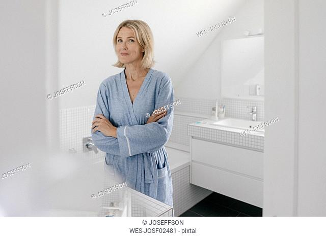 Portrait of confident mature woman in bathroom