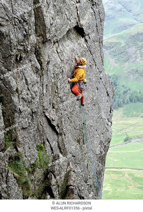 United Kingdom, Lake District, Langdale Valley, Gimmer Crag, climber on rock face